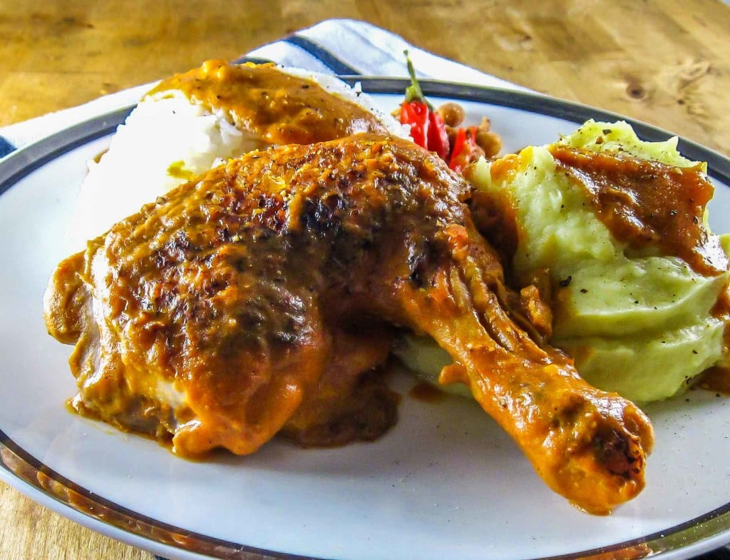 Congo Moambe Chicken serving suggestion with rice and fufu